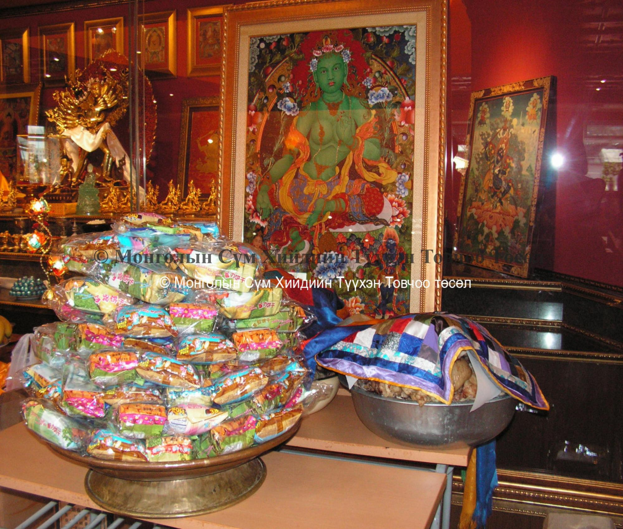 Offering on the altar in front of Green Tara