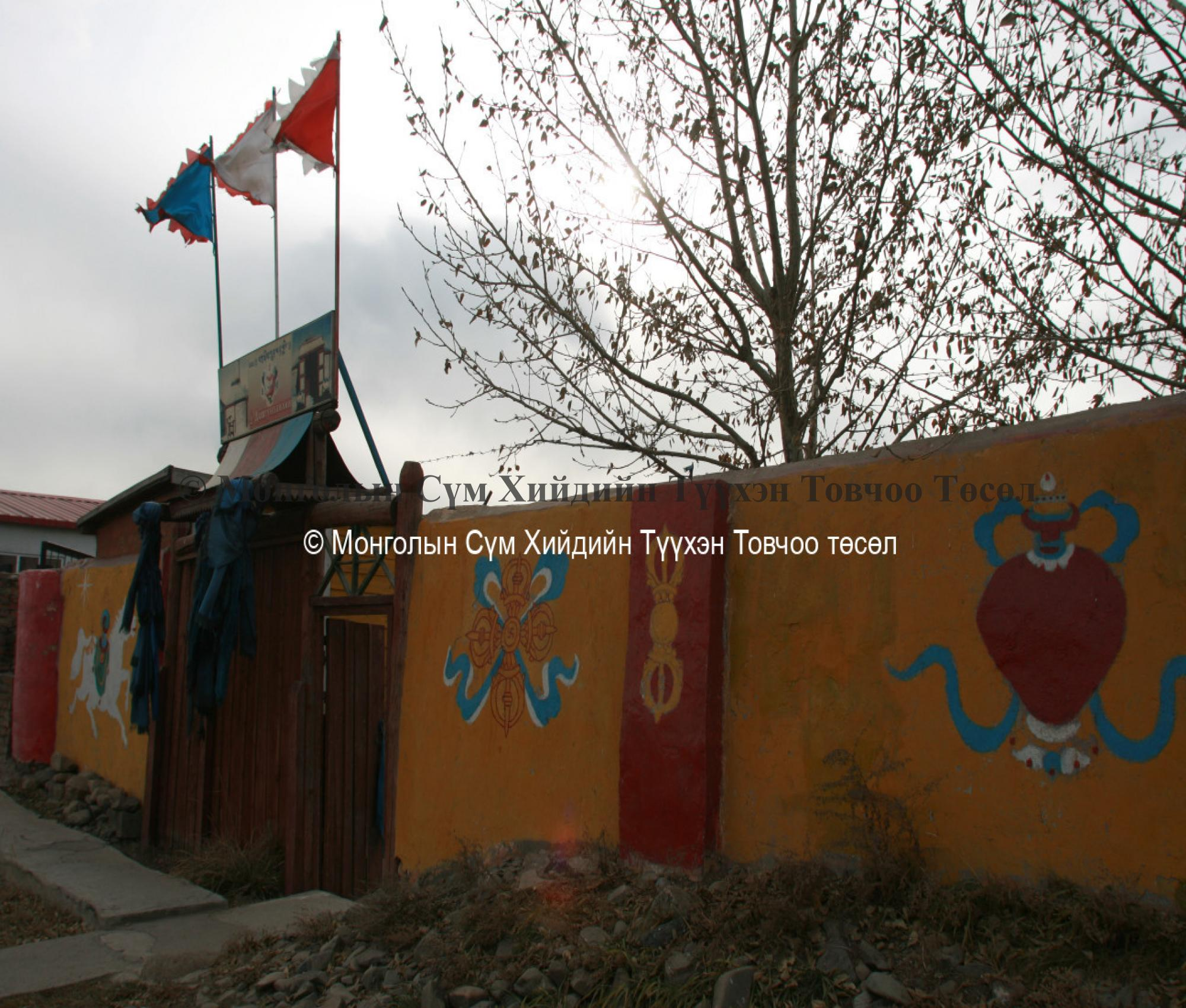Buddhist symbols decorating the wall surrounding t