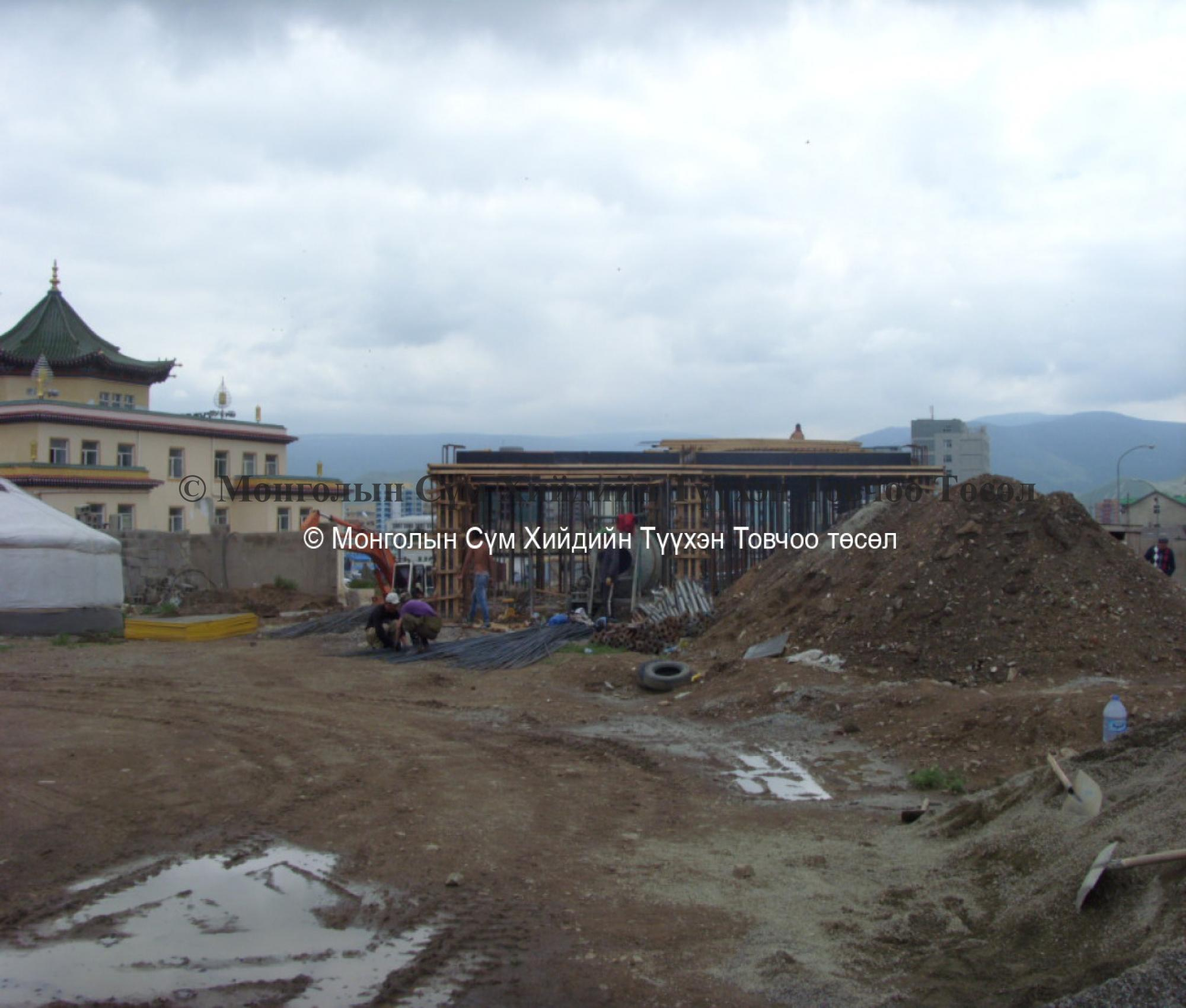 Another building is being built behind the temple