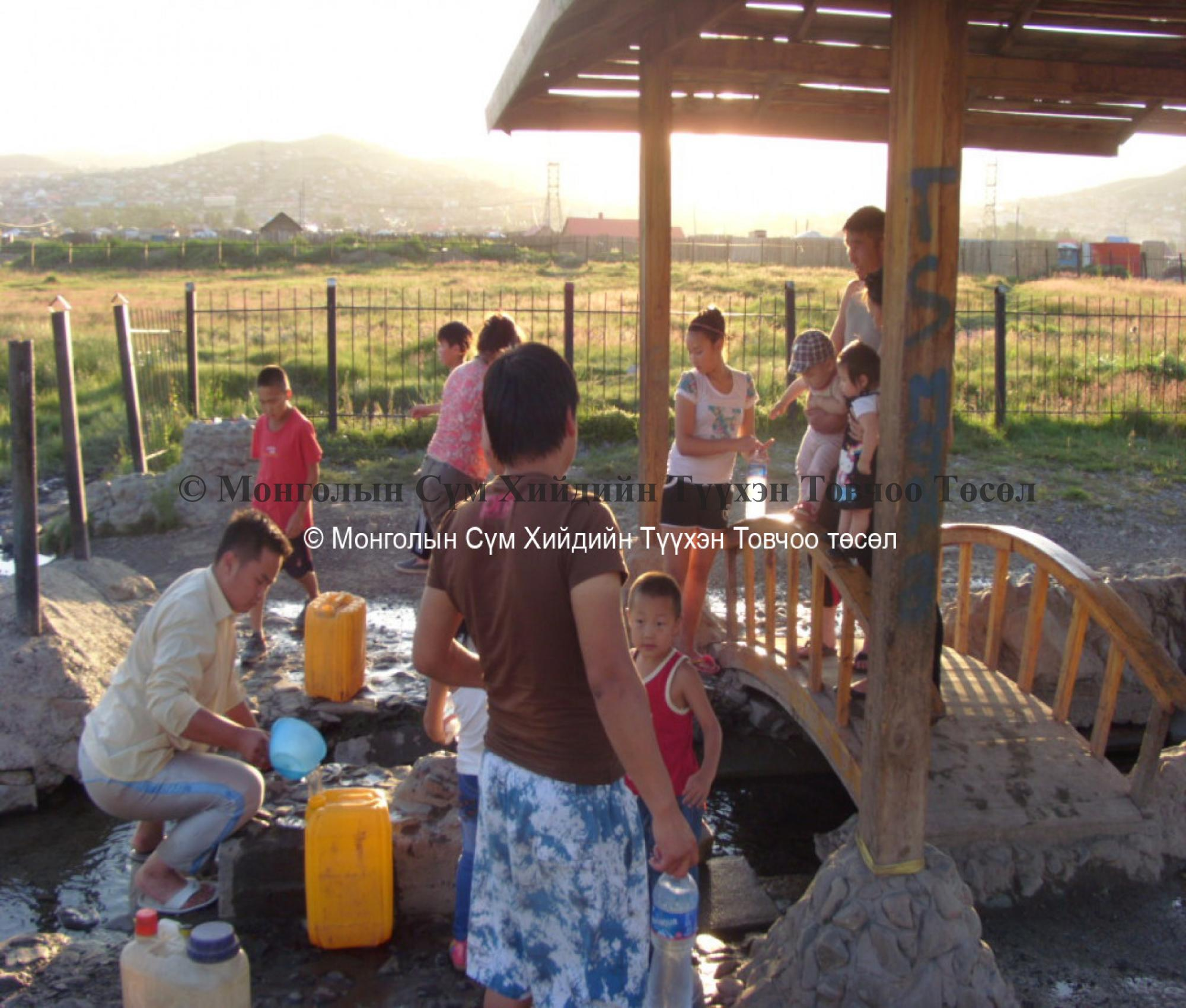 Local people taking water of the spring 2007
