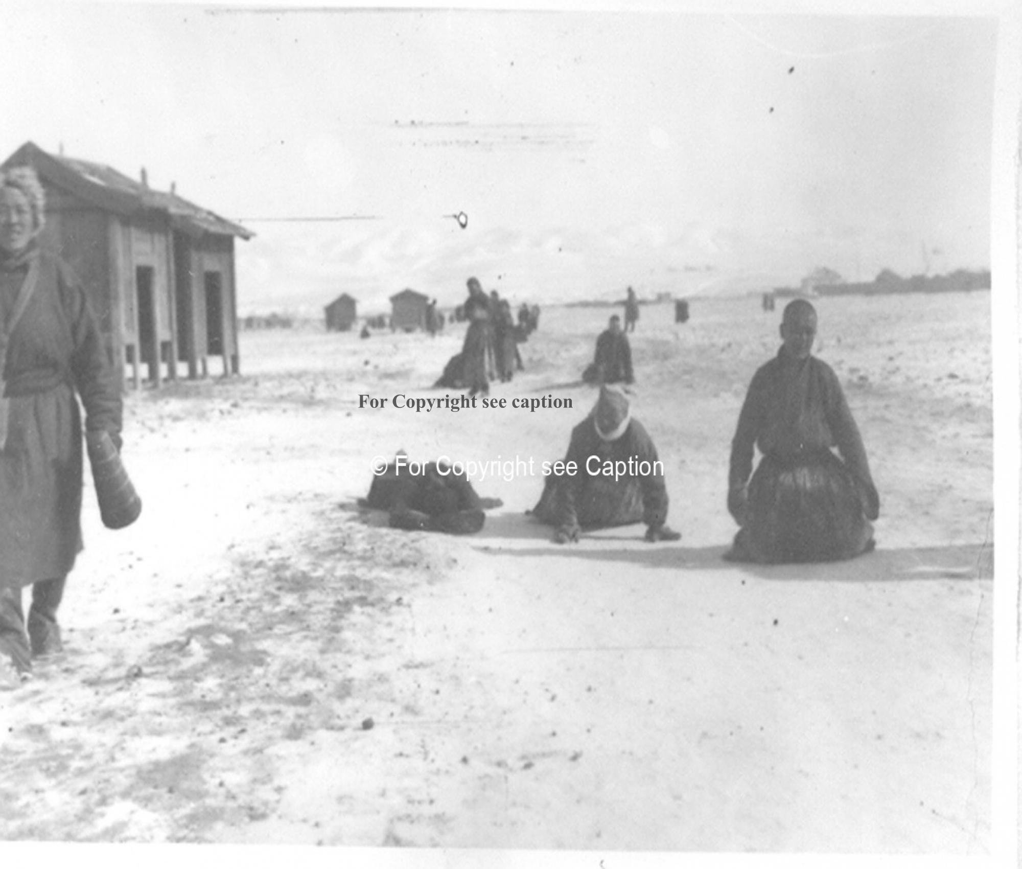 Prostration on the goroo circumambulation road. Film Archives K-24835