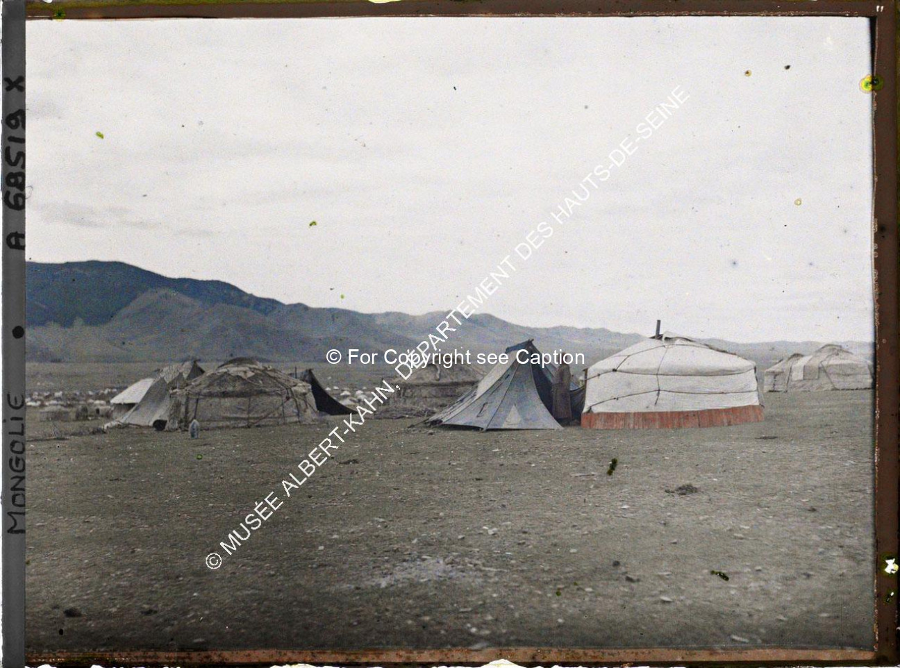 Yurts and tents near Jarankhashar stupa. Musée Albert-Kahn. A68519. Photo taken by Stéphane Passet,
