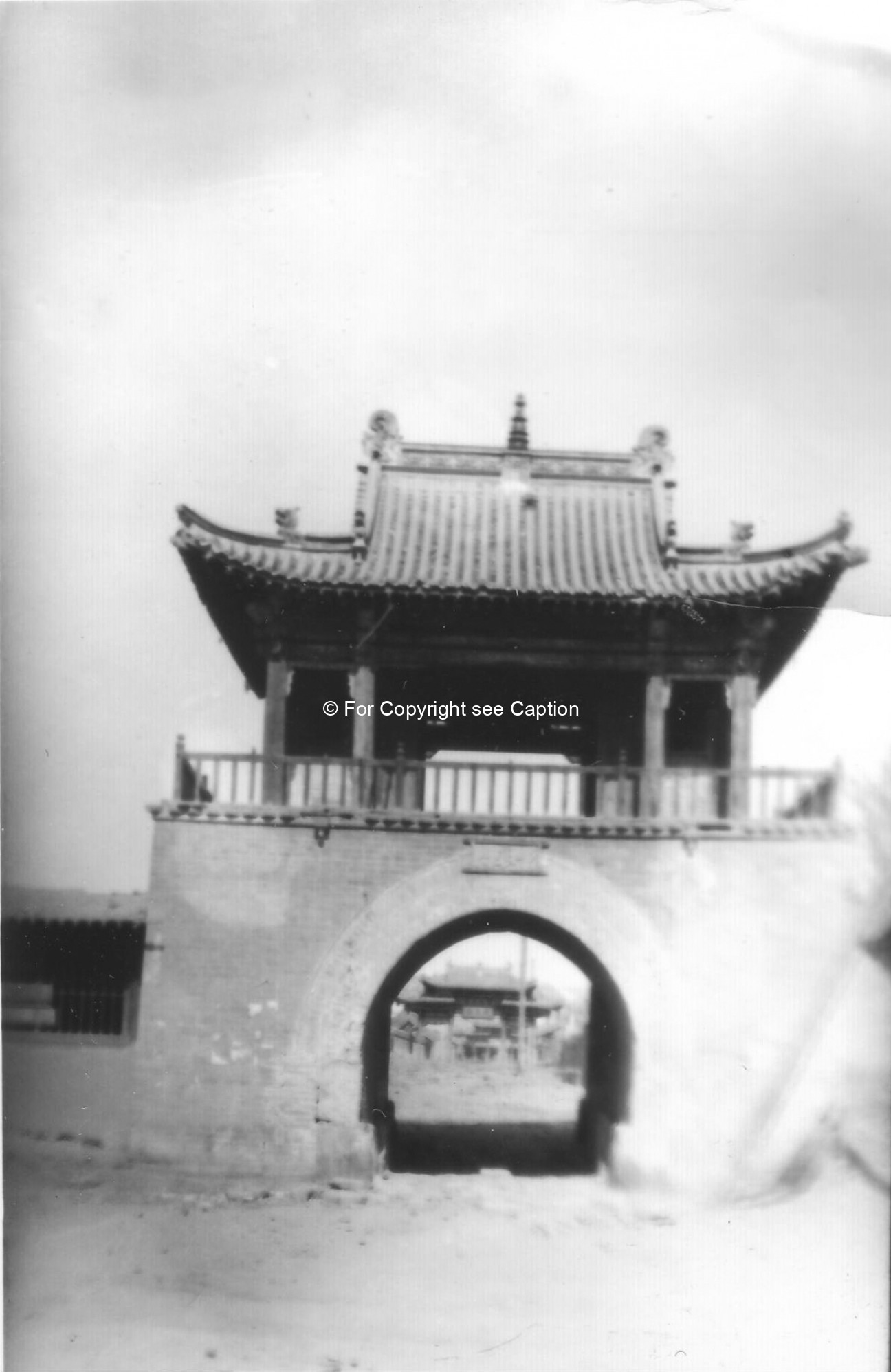 South gate of Maimaachen (?) with the entrance of Geser Temple ?. Film Archives ?
