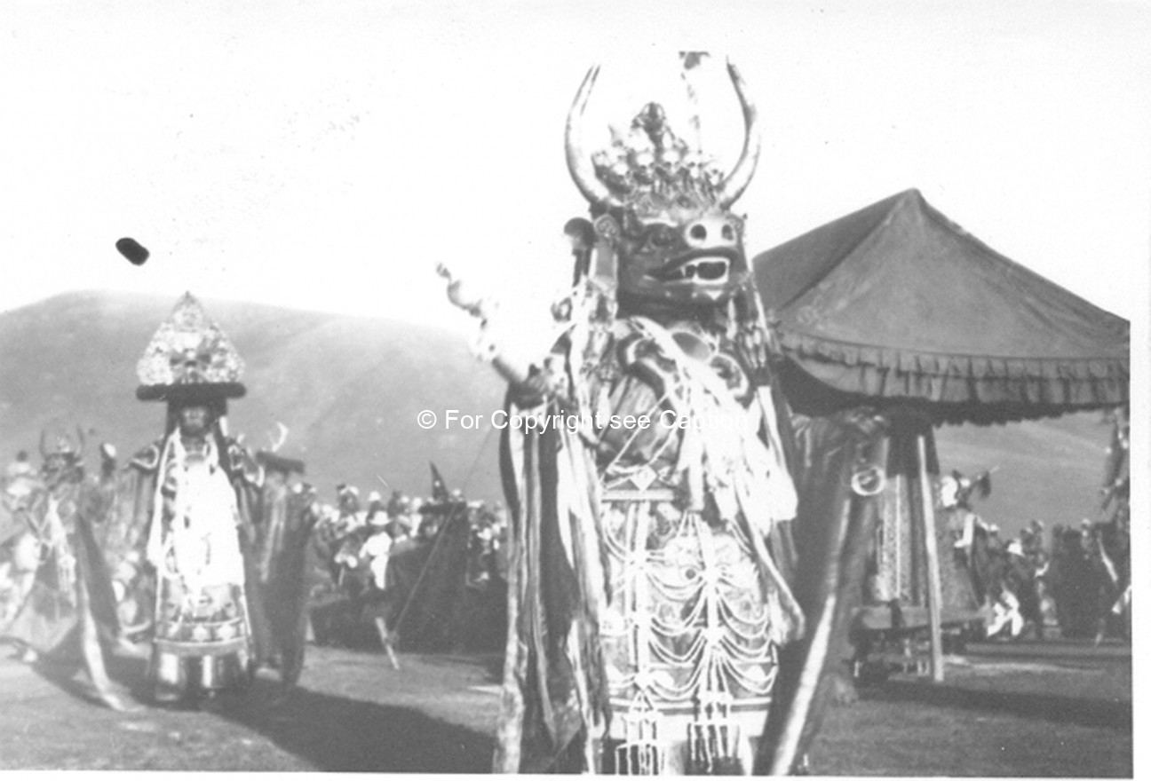Tsam dance: the Lord of Death (Choijoo) and his escort (Chambon) near the Soriin Asar tent. Film Arc